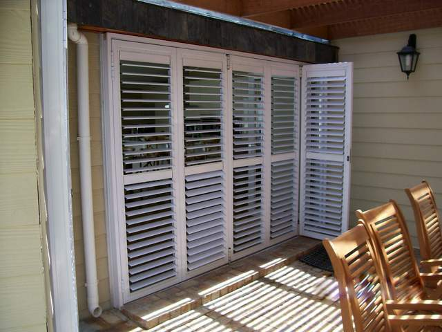 SECURITY AND ADJUSTIBLE-BLADE SHUTTERS
